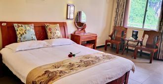 Junshe Boutique Guest House - Guilin - Bedroom