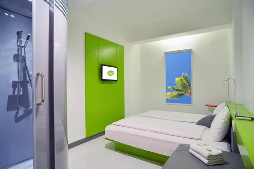 珀豪酒店雷吉安斯里峇里 - 庫塔 - 庫塔 - 臥室