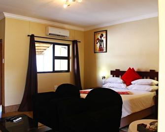 Mango Guesthouse - Ongwediva - Bedroom