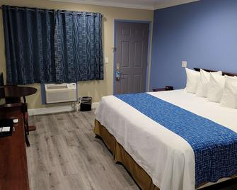 Travelodge by Wyndham Clearlake - Clearlake - Спальня