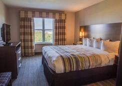 Country Inn & Suites by Radisson, Harlingen, TX - Harlingen - Κρεβατοκάμαρα