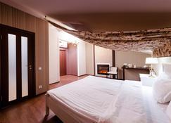 Hotel Kupecheskiy Dom - Tomsk - Bedroom