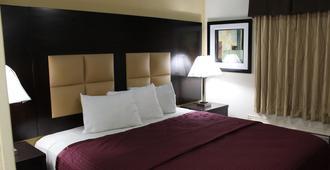 Apple Inn - דאלאס - חדר שינה