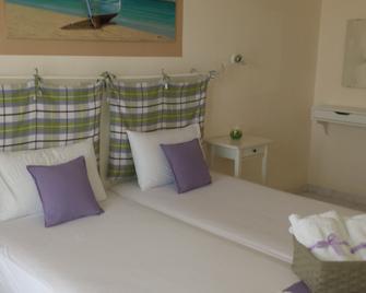 Akrogiali Hotel - Skala - Slaapkamer