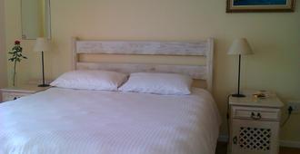 Nell's B&B - De Kelders - Schlafzimmer