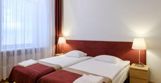 Hotel Metropolis - Kauen - Schlafzimmer