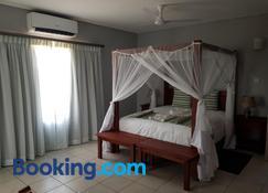 Tlou Safari Lodge - Kasane - Sypialnia