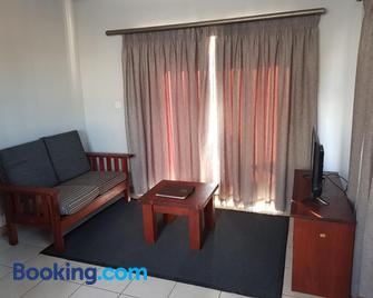 Tlou Safari Lodge - Kasane - Living room