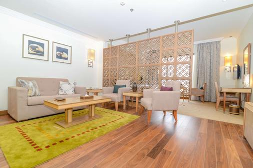 Golden Tulip Dammam Corniche Hotel - Dammam - Living room