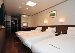 Global Inn 東大門城市戴斯酒店 - 首爾 - 臥室