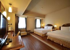 Goodness Hotel - Каогсіунг - Спальня