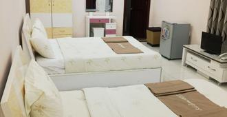 Mekong Hotel - הו צ'י מין סיטי - חדר שינה