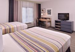 Country Inn & Suites by Radisson RaleighDurham Air - Morrisville - Phòng ngủ