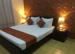 Hotel Executive Lodges - Bahāwalpur - Bedroom