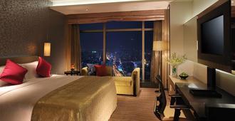 Wongtee V Hotel - שנג'ן - חדר שינה