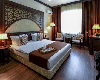 Hotel Orient Star Samarkand - Samarkand - Bedroom