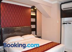 Puncak Budget Hotel - Pangkalpinang - Bedroom