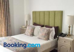 Hotel Central Jardim - Герес - Спальня
