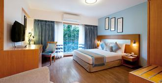 Grand Residency Hotel & Serviced Apartments - Mumbai - Schlafzimmer