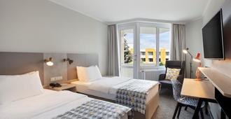 Holiday Inn Munich - South - מינכן - חדר שינה