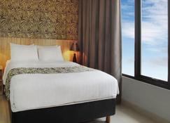 The Green Hotel Bekasi - Бекаси - Спальня