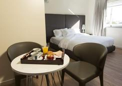 Regency Way Montevideo Hotel - Montevideo - Phòng ngủ