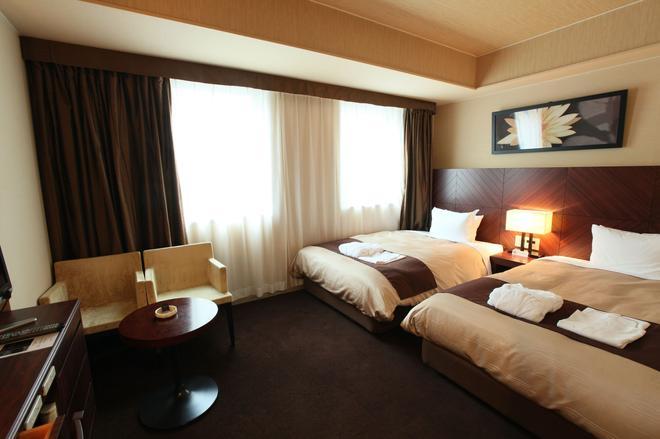 名古屋拉古娜婚宴會場暨套房飯店 - 名古屋 - 臥室