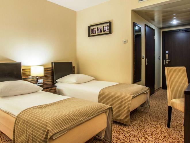 Qubus Hotel Kielce - Kielce - Schlafzimmer