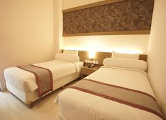 Viva Hotel Kediri by Front One - Kediri - Slaapkamer