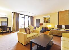 Protea Hotel by Marriott Kampala - Kampala - Slaapkamer