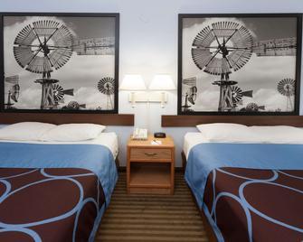 Super 8 by Wyndham Huntington - Huntington - Schlafzimmer