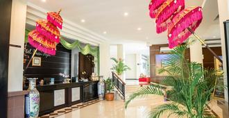 Hotel Puri Ayu - דנפסאר - דלפק קבלה