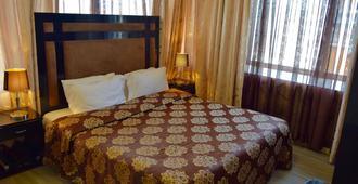 New Avon Apartments - דר א-סאלאם - חדר שינה