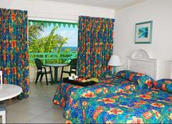 Blue Orchids Beach Hotel - Bridgetown - Bedroom