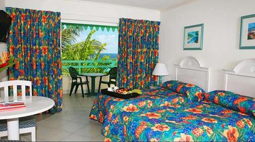 Blue Orchids Beach Hotel - Μπριτζτάουν - Κρεβατοκάμαρα