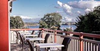 Hotel Kyriad Saint-Malo Ouest-Dinard - Dinard - Balcón