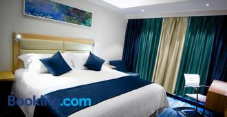 LYZ Business Hotel - Lima - Camera da letto