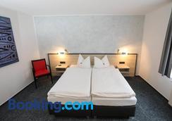 Hotel 7 Saulen - Dessau-Rosslau - Bedroom