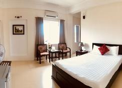 Nam Long Plus Hotel - Dong Hoi - Quarto