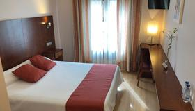 Hotel Jaqués - Jaca - Camera da letto