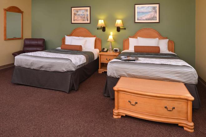 Country Hearth Inn & Suites Edwardsville St. Louis - Edwardsville - Bedroom