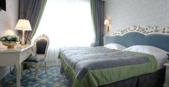 Royal Olympic Hotel - קייב - חדר שינה