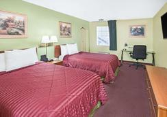 Days Inn & Suites by Wyndham Terre Haute - Terre Haute - Bedroom