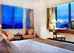Aston Jayapura Hotel and Convention Center - Jayapura - Schlafzimmer