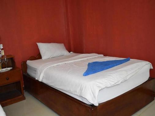 Les Parigots Guesthouse - Siem Reap - Phòng ngủ