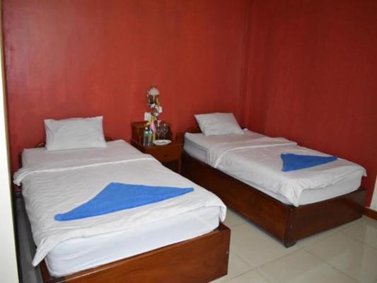 Les Parigots Guesthouse - Khett Siem Reab - Slaapkamer