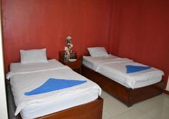 Les Parigots Guesthouse - Siem Reap - Bedroom