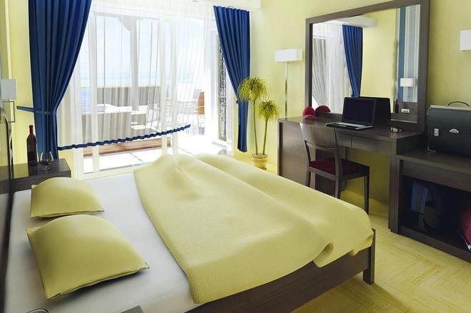 馬卡里溫泉套房酒店 - 雷西姆農 - 羅希姆諾 - 臥室