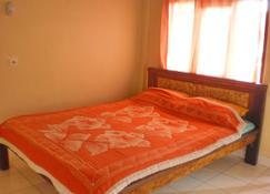 Arjuna Homestay Ubud - Ubud - Bedroom