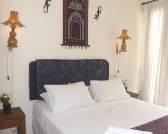 Qambodja Villas Lombok - Mangsit - Bedroom